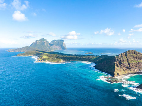 Stunning aerial panorama drone view of Lord Howe Island, an Australian pacific subtropical island in the Tasman Sea between Australia and New Zealand. Famous Ned's Beach in the foreground.