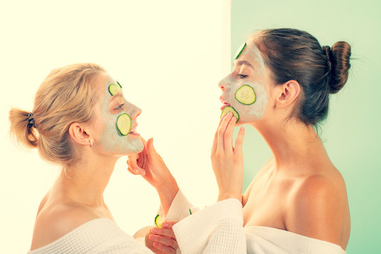 Girls friends sisters in bathrobes making clay facial mask. Anti age care. Stay beautiful. Skin care for all ages. Women having fun skin mask. Pure beauty. Beauty product. Spa and beauty care
