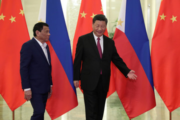 Philippine President Rodrigo Duterte and Chinese President Xi Jinping walk to a meeting at the Great Hall of People in Beijing