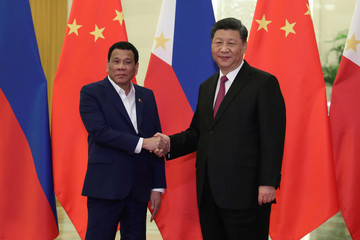 Philippine President Rodrigo Duterte shakes hands with Chinese President Xi Jinping before the meeting at the Great Hall of People in Beijing