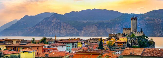 Lago di Garda village skyline of Malcesine peaceful panoramic town on  waterfront romantic horizontal panorama and idyllic picturesque castle