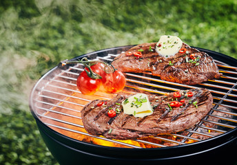 Tender portions of rump steak grilling on a fire