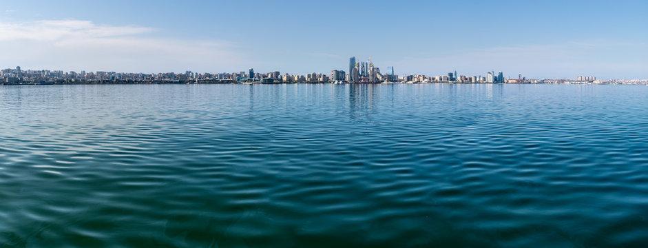 Baku, Azerbaijan - April 13, 2019: Panoramic sunny summer view of Baku, capital city of Azerbaijan. Panorama Baku from The Caspian Sea