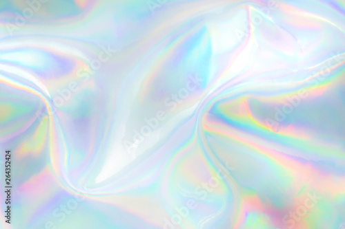 Wall mural Abstract trendy holographic background. Real texture in pale violet, pink and mint colors with scratches and irregularities
