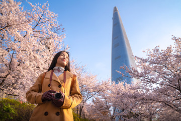 Asian lady travel and warking in cherry blossom park