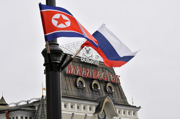 State flags of Russia and North Korea fly in a street in Vladivostok