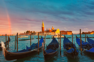 Foto op Canvas Gondolas Colorful landscape with sunset sky, rainbow and gondolas parked near piazza San Marco in Venice. Church of San Giorgio Maggiore in the background, Italy. Europe tourism concept.
