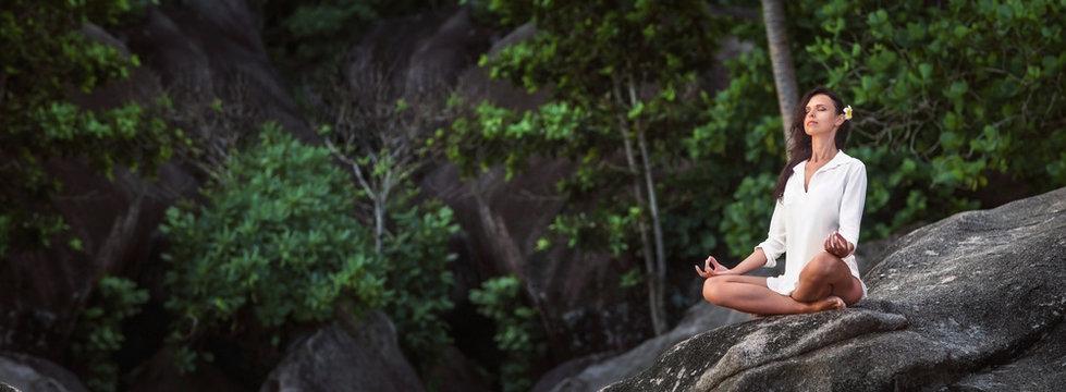 Woman Practicing Lotus Pose Enjoying Nature