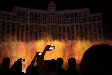 silhouette group of people take photo at  famous fountain of Bellagio, Las Vegas,USA,09April2019