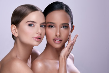 two young girls with naked shoulders and nude make-up