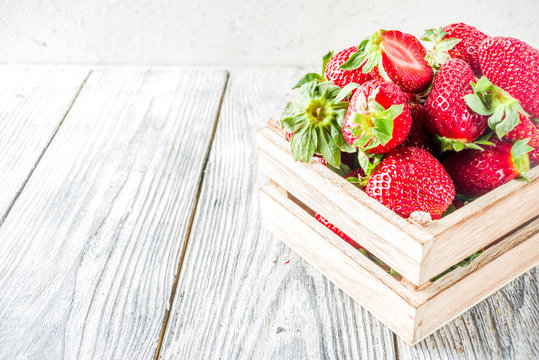 Fresh strawberry on wooden box, copy space