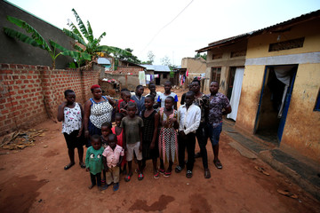 Mariam Nabatanzi, a mother of 38, takes a family portrait with some of her children at their home in Kasawo village
