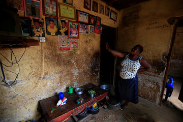 Mariam Nabatanzi 39, a mother of 38 children, speaks about her family portraits during a Reuters interview at her home in Kasawo village