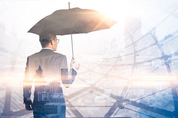 Obraz The double exposure image of the Businessmen are spreading umbrella during sunrise overlay with cityscape image. The concept of modern life, business, insurance and protection. - fototapety do salonu