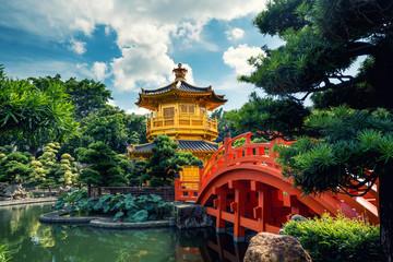 Front view the Golden pavilion temple with red bridge in Nan Lian garden, Hong Kong. Asia. Wall mural