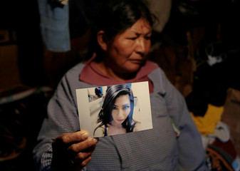 Bartolina Ramos holds a photography of her daughter Vethy Mamani Ramos, a university student and model, who was found dead under a bridge in La Paz on September 30, 2017, in La Paz