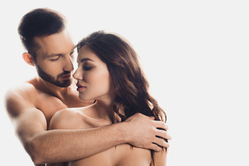 handsome bearded man embracing nude girlfriend isolated on white