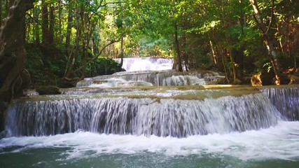 Wall Mural - Waterfall flow standing with forest enviroment low angle view in thailand called Huay or Huai mae khamin in Kanchanaburi Provience, Thailand., Tilt down.