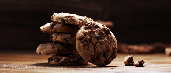 Chocolate cookies on wooden table. Chocolate chip cookies