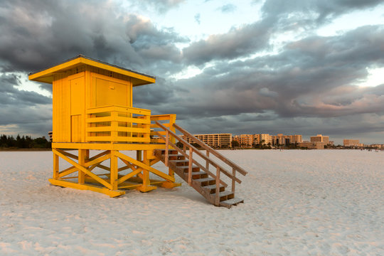 Yellow Lifeguard Tower Under Dramatic Sky
