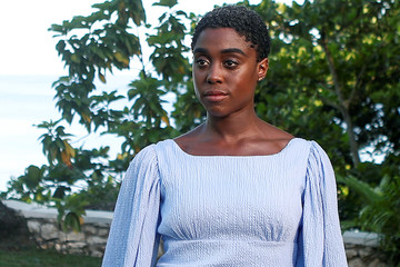 """Actor Lashana Lynch poses for a picture during a photocall for the British spy franchise's 25th film set for release next year, titled """"Bond 25"""" in Oracabessa"""