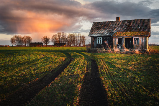 Old abandoned house in the fields.