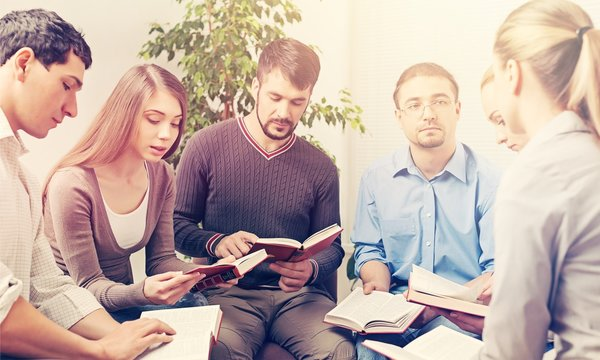 Group of people Reading Bible book Together