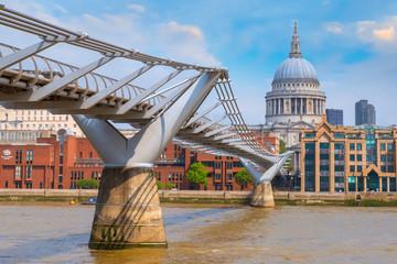 London, UK - May 23 2018: View of St Paul's Cathedral with people crossing the Millenium Bridge (London Millennium Footbridge)