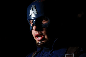 """Avengers fan Griffin Reina dresses as Captain America at the TCL Chinese Theatre in Hollywood as he attends the opening screening of """"Avengers: Endgame"""" in Los Angeles"""
