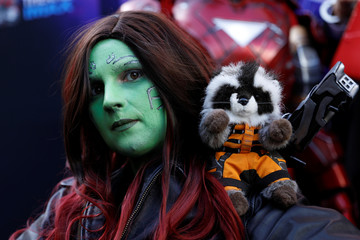 """An Avengers fan poses as she arrives dressed as Gamora at the TCL Chinese Theatre in Hollywood to attend the opening screening of """"Avengers: Endgame"""" in Los Angeles"""