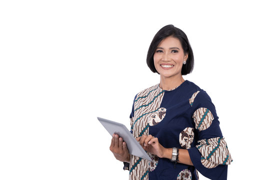 asian middle aged woman with tablet isolated over white background