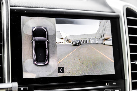 Working of front camera of circular 360 degrees view system. Image display on the head unit. Multimedia in the car. Options inside automobile