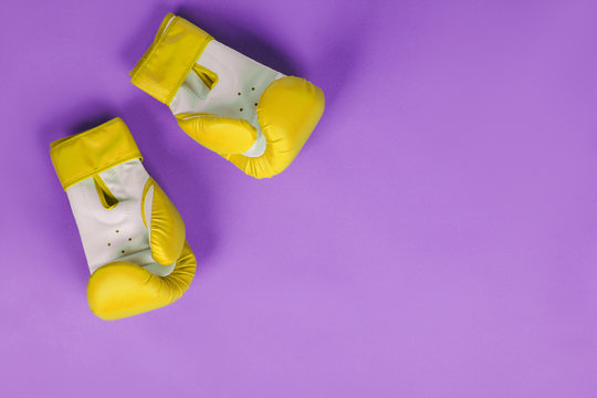yellow boxing gloves on a purple background
