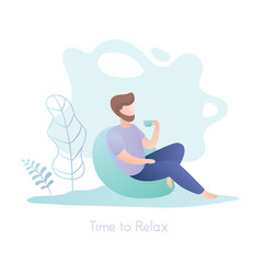 Fototapeta Male hipster with a cup sitting in a chair, relax time obraz