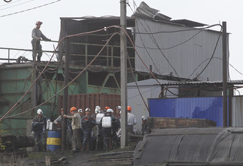 Miners and rescuers gather at a coal mine following a methane explosion near Luhansk