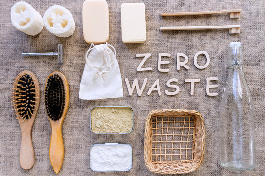 Zero waste natural organic ecological bathroom, plastic free life, flat home concept. Glass jar, wooden soap dish, metal box with dentifrice, items stuff teeth hair brush washcloth cosmetic background