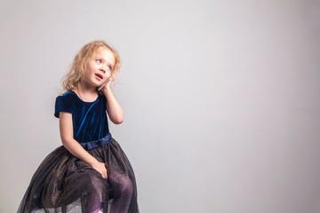 Little girl emotional talking on mobile phone