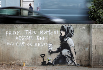 Graffiti believed to have been created by street artist Banksy, is seen at the site where hundreds of Extinction Rebellion climate protestors camped recently, at Marble Arch in London