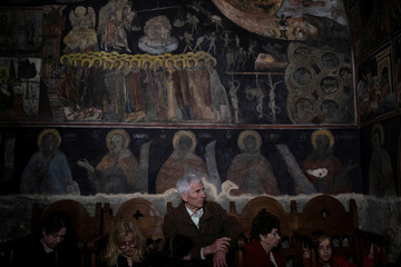Orthodox faithful attend a mass at the chapel of Penteli monastery on Good Friday, before a ceremony re-enacting Jesus Christ's Deposition from the Cross in Athens