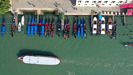 Aerial drone top view photo of iconic and unique colourful Gondolas in Grand Canal near Rialto bridge, Venice, Italy Fototapete