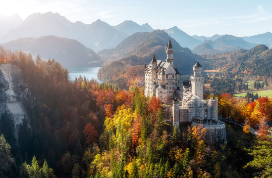 Summer Germany. Morning in the Bavarian Mountains. Castle Neuschwanstein in the light of the rising sun. Awesome alpine highlands in sunny day.  Popular Photography Locations. Beautiful of the world
