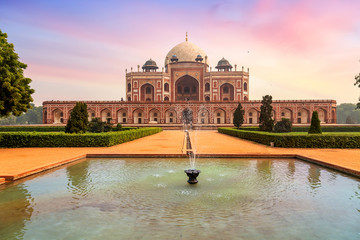 Wall Mural - Medieval red sandstone architecture Humayun Tomb complex Delhi at sunset. Humayun Tomb is a UNESCO World Heritage site