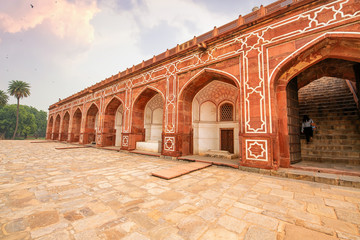 Fototapete - Medieval architecture made of red sandstone and marble at Humayun Tomb Delhi at sunset