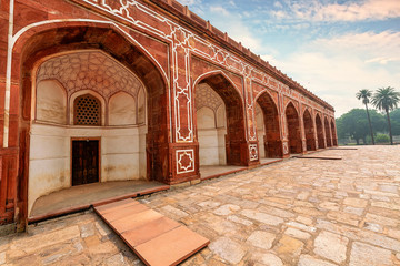 Fototapete - Ancient Indian architecture made of red sandstone and marble at Humayun Tomb Delhi at sunset