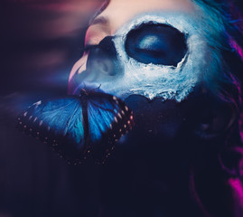 Foto op Aluminium Body Paint Beautiful woman with blue hair and butterfly