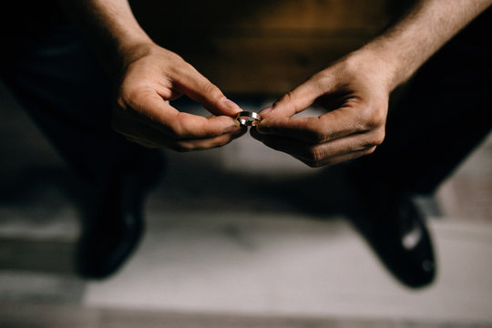 man holds rings