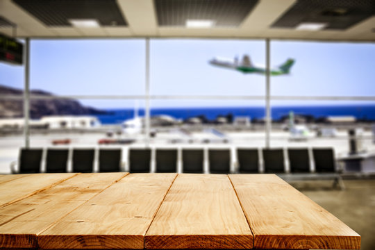 Desk of free space and airport background