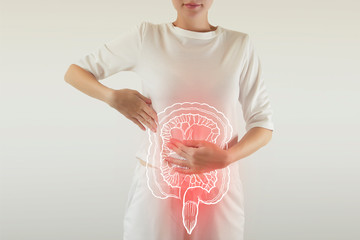 Digital composite of highlighted redinjured or infected intestine of woman