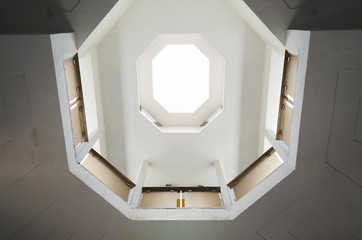 Octagon photomending symmetry in a building with light input architectural lines