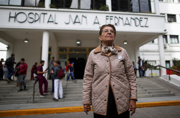"""Maria Rosa Pallone, president of the NGO """"Quienes Somos?"""" (who are we?), poses for a picture in front of the Juan A. Fernandez hospital, in Buenos Aires"""
